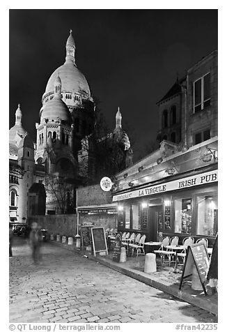 Sacre-Coeur basilica and restaurant by night, Montmartre. Paris, France (black and white)