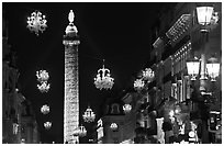 Christmas lights and Place Vendome column by night. Paris, France ( black and white)