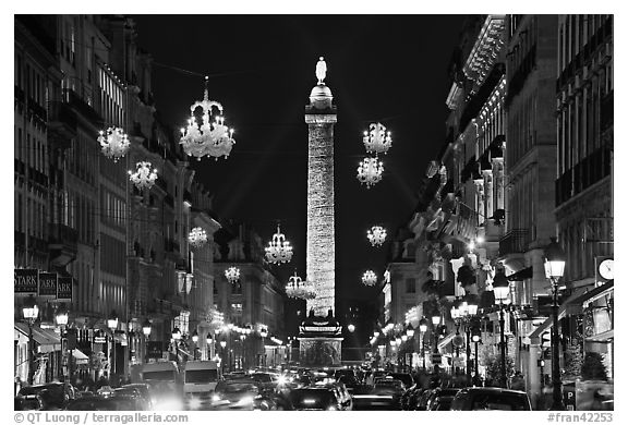 Street with lights and Place Vendome column. Paris, France (black and white)