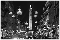 Street with lights and Place Vendome column. Paris, France ( black and white)