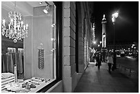 Luxury storefront and Place Vendome column by night. Paris, France (black and white)