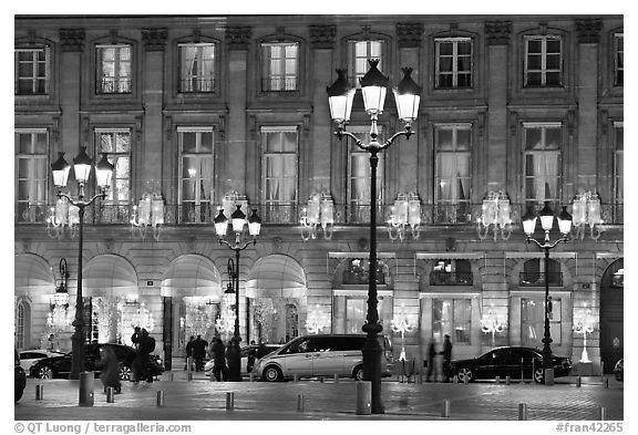 Lights and palace-like classical fronts of Hotel Ritz by Jules Hardouin-Mansart. Paris, France (black and white)
