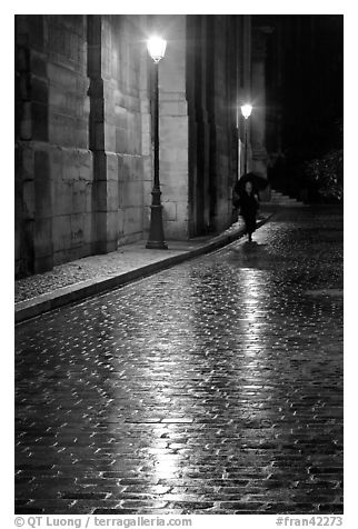 black and white picture photo street lamps reflected in wet pavement with woman walking paris. Black Bedroom Furniture Sets. Home Design Ideas
