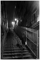 Woman climbing steep steps to the Butte, Montmartre. Paris, France (black and white)