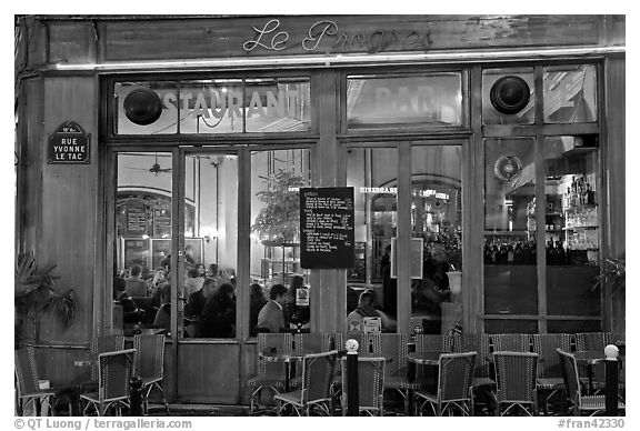 Popular cafe restaurant by night. Paris, France (black and white)