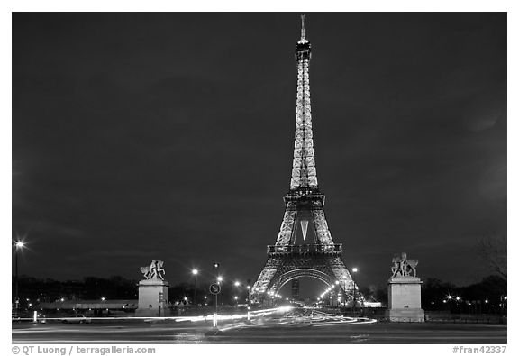 Eiffel Tower seen across Iena Bridge at night. Paris, France (black and white)