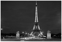 Eiffel Tower seen across Iena Bridge at night. Paris, France ( black and white)