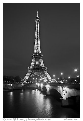 Black and white picture photo seine river iena bridge and illuminated eiffel tower paris france