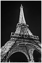 Illuminated  Eiffel Tower seen from close. Paris, France (black and white)