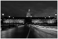 The Invalides: Mansart's dome above Bruant's pedimented central block by night. Paris, France (black and white)