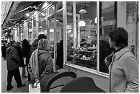 Customers wait in line in front of a popular bakery. Paris, France (black and white)