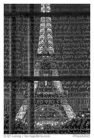 Illuminated Eiffel Tower seen through peace memorial. Paris, France (black and white)