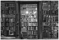 Books on shelves seen through storefront. Quartier Latin, Paris, France (black and white)