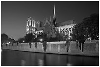 Side view of Notre Dame across Seine River at dusk. Paris, France ( black and white)