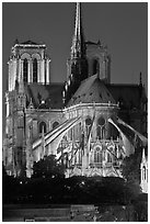 Chevet (head) and buttresses of Notre-Dame by night. Paris, France (black and white)