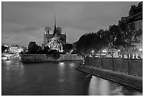 Banks of the Seine River, Ile de la Cite, Ile Saint Louis, and Notre Dame at twilight. Paris, France (black and white)