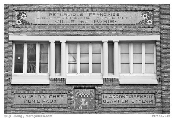 Facade of historic public baths. Paris, France (black and white)
