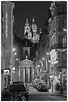 Street, Notre-Dame-de-Lorette, and Sacre Coeur at night. Paris, France (black and white)