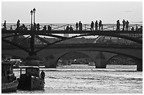 Seine river and people silhouettes on Pont des Arts. Paris, France (black and white)