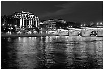 Pont Neuf and Samaritaine reflected in Seine River at night. Paris, France ( black and white)