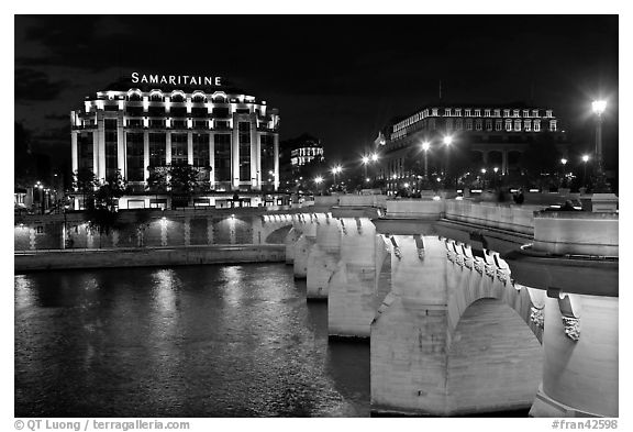 Pont Neuf and Samaritaine illuminated at night. Paris, France (black and white)