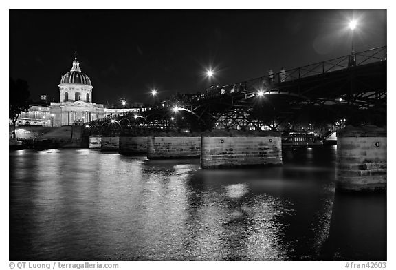 Institut de France, Pont des Arts and Seine reflections at night. Paris, France (black and white)