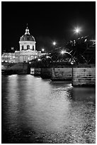 Institut de France and Pont des Arts reflected in Seine river at night. Paris, France (black and white)