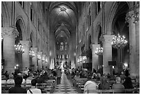 Interior of Notre-Dame de Paris during mass. Paris, France (black and white)