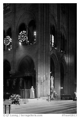 Cardinal reading and crossing of Notre-Dame cathedral. Paris, France (black and white)
