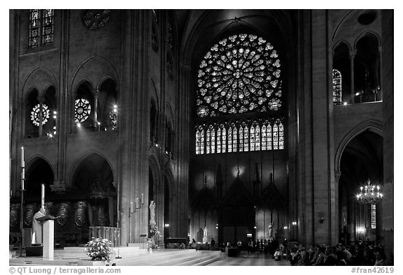 Bishop celebrating mass, South transept, and stained glass rose. Paris, France (black and white)
