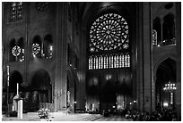 Bishop celebrating mass, South transept, and stained glass rose. Paris, France ( black and white)