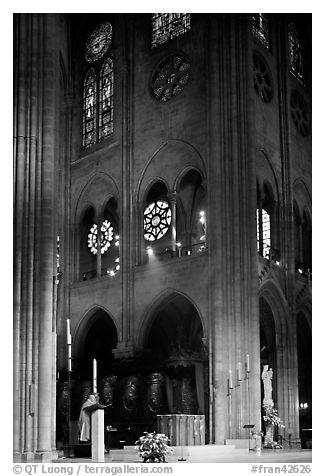 Cardinal reading and choir of Notre-Dame cathedral. Paris, France (black and white)