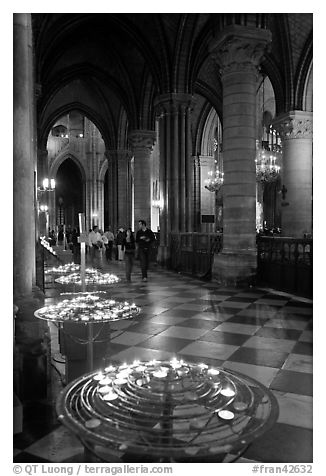 Candles in aisle, Notre-Dame-de-Paris. Paris, France (black and white)