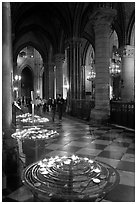 Candles in aisle, Notre-Dame-de-Paris. Paris, France ( black and white)