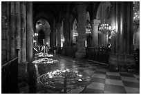 North Aisle and candles, cathedral Notre-Dame-de-Paris. Paris, France ( black and white)