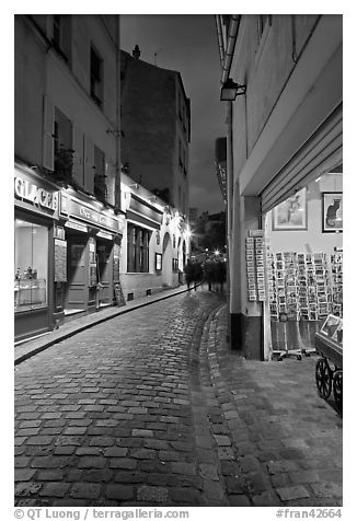 Pedestrian cobblestone street and tourist business, Montmartre. Paris, France (black and white)