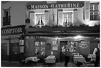 Restaurant and waiter at night, Montmartre. Paris, France ( black and white)