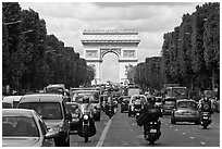 Car and motorcycle traffic and Arc de Triomphe, Champs-Elysees. Paris, France ( black and white)