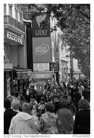 Pedestrians on a Champs-Elysees sidewalk. Paris, France (black and white)