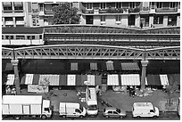 Aerial portion of metro from above, with public market stalls below. Paris, France (black and white)