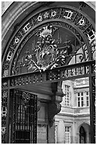 Gate and emblem of the city of Paris, Carnevalet Museum. Paris, France (black and white)