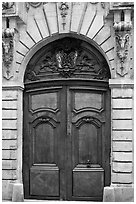 Ancient wooden door, le Marais. Paris, France (black and white)
