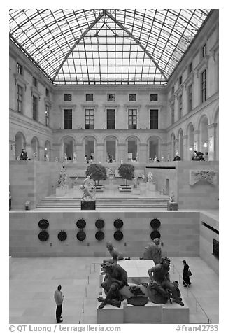 Visitors in the Louvre museum. Paris, France (black and white)