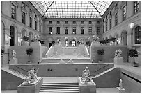 Louvre Museum room with sculptures and skylight. Paris, France ( black and white)