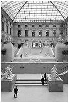 Visitors and exhibit inside Louvre museum. Paris, France ( black and white)