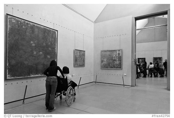 Tourist in wheelchair, Orsay Museum. Paris, France (black and white)