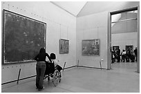 Visitor in wheelchair, Orsay Museum. Paris, France (black and white)