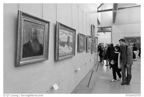 Couple looking at impressionists paintings, Orsay Museum. Paris, France (black and white)
