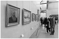 Couple looking at impressionists paintings, Orsay Museum. Paris, France ( black and white)