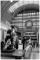 Sculpture and historic clock inside Orsay Museum. Paris, France (black and white)